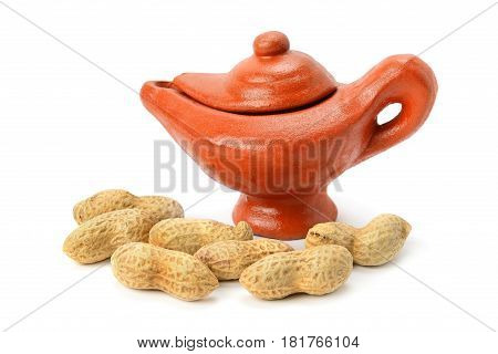 Peanuts and clay amphora isolated on white background
