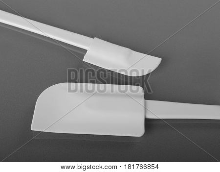 Two white silicone spatulas or dough scraper