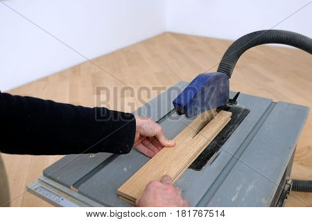 Worker cut parquet in dimension in work place