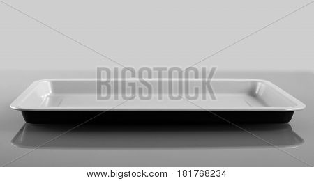 Empty plastic shallow dish on gray background, front view