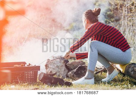 Girl Sitting On A Log
