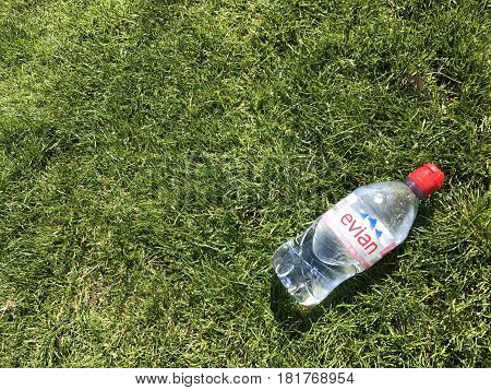 Iasi, Romania - April 10, 2017: Bottle Of Evian Water On The Green Grass
