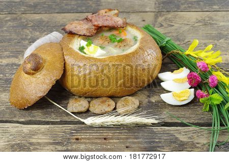 sour soup in bread with sauage and egg