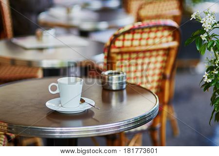 Coffee Cup On A Table Of Parisian Outdoor Cafe