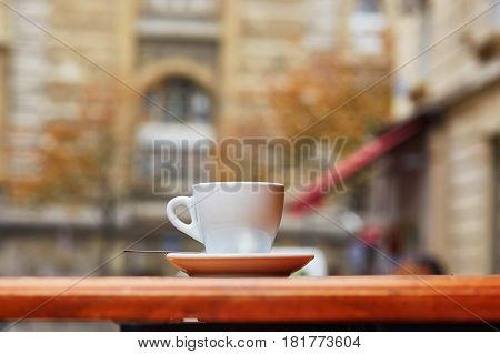 Cup With Hot Beverage In Parisian Outdoor Cafe