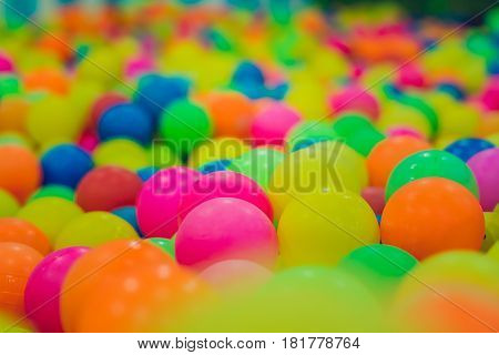 Multi-colored plastic balls. A children's playroom. Creativity Game concept.