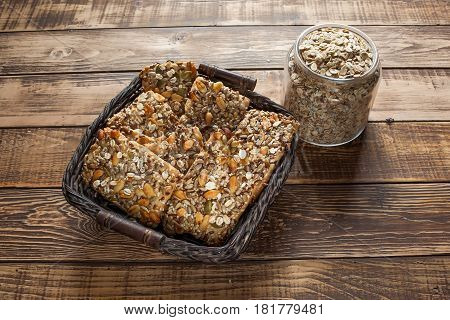 Baked oats with dry fruits, a jar with oats on wooden table