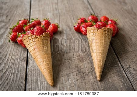 Strawberries shaped and ice cream cones background