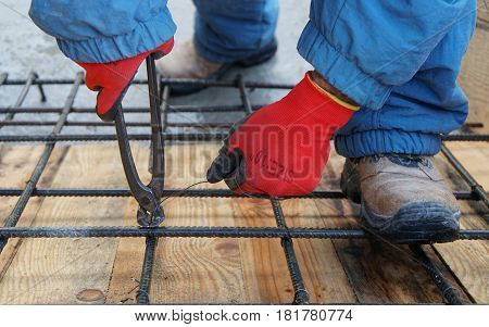 Construction worker working on steel rods used to reinforce concrete