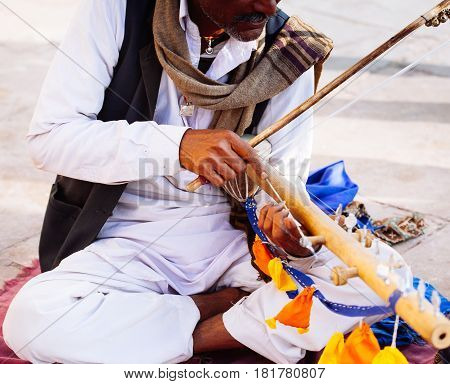 Udaipur, India - January 12, 2017:  Musician Playing Traditional Rajasthani Music On The Street Of U