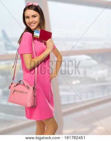 Young travelling girl at airport
