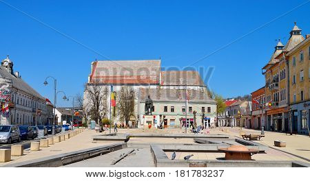 TURDA ROMANIA - 04.04.2017: Republic Square and Avram Iancu statue landmark architecture