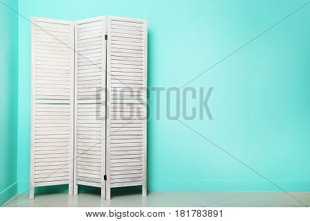 Wooden Folding Screen On A Green Background