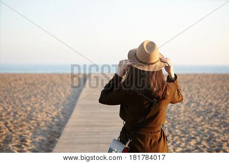 Outdoor Image Of Unrecognizable Caucasian Female Novel Writer Visiting European Sea Beach For Inspir