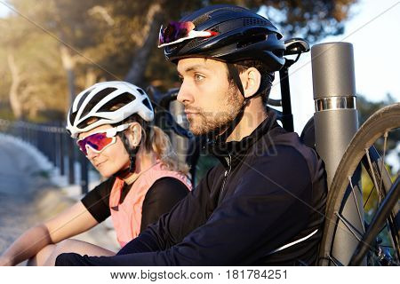 Healthy And Active Lifestyle. Two Cycle-travelers Resting On Bridge In Morning After Long Ride, Sele