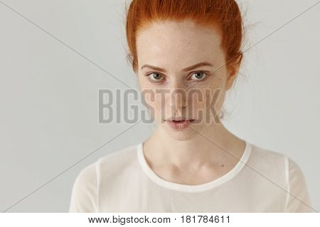 Picture Of Red-haired Teenage Girl With Charming Smile And Soft Tender Features Posing In Studio. Be