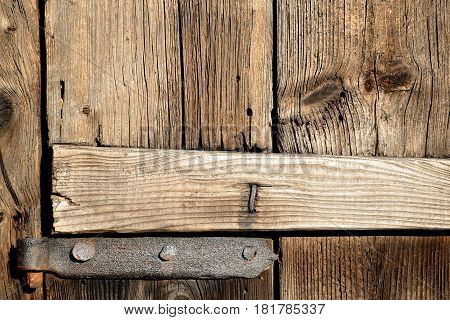 vintage hand-forged hinges on old wooden door