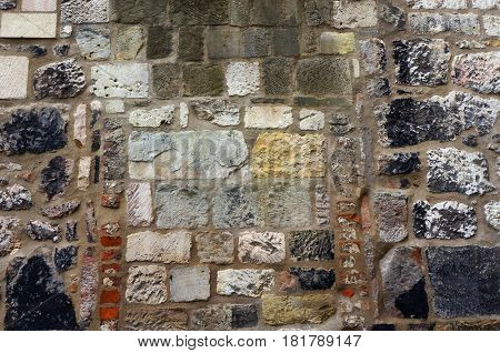 Stone and brick wall. Architectural textured background.