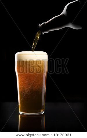 Beer Being Poured Into Glass