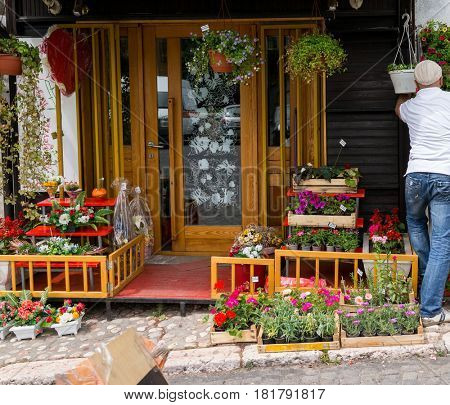 Man in fron of his flower store