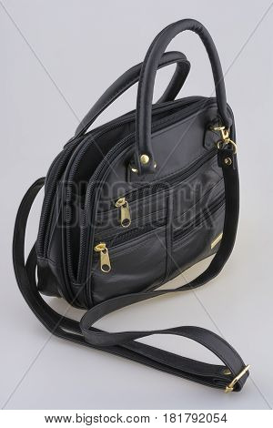 small ladies leather bag on a white background