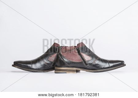 Men's leather ankle boots on white background