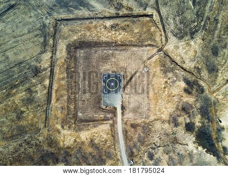 Helipad for helicopter landing within greenery setting view from above