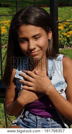 Teen Girl With Her Hands Over Heart