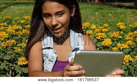 A Teen Girl Using A Tablet PC