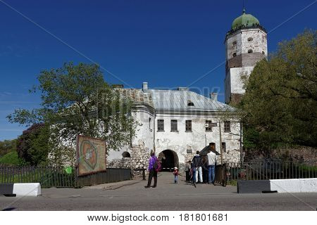 VYBORG, LENINGRAD OBLAST, RUSSIA - JUNE 6, 2015: People in front of the entrance and on the tower of St. Olav of Vyborg Castle. The castle was founded in 1293