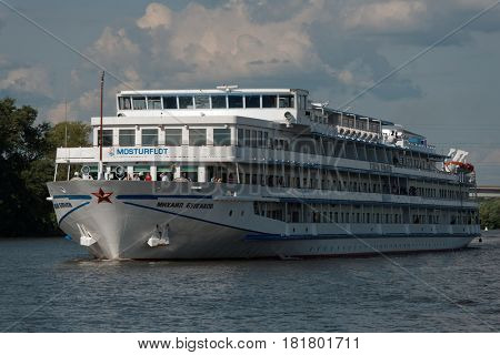 MOSCOW, RUSSIA - JULY 4, 2014: River cruise ship of the Mostourflot company on the Moscow canal. The company offers luxury river cruises to St. Petersburg, Onega lake, etc.