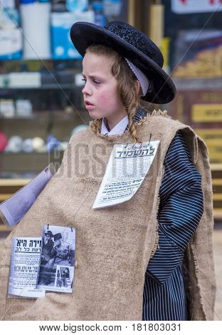 JERUSALEM - MARCH 13 : Ultra Orthodox child during Purim in Mea Shearim Jerusalem on March 13 2017 Purim is a Jewish holiday celebrates the salvation of the jews from genocide in ancient Persia