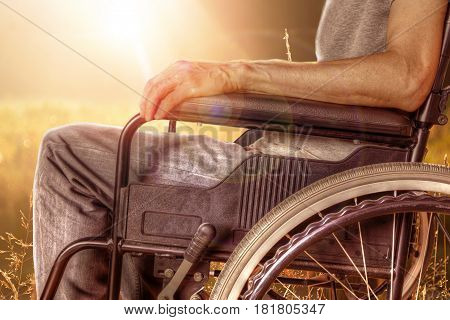 Closeup Of Man On Wheelchair Enjoying Nature