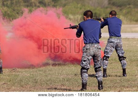 Soldiers in assault shooting with weapon Training weapon
