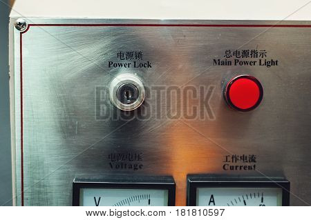 Control panel in main engine room. inscriptions in English and Chinese. Selective focus