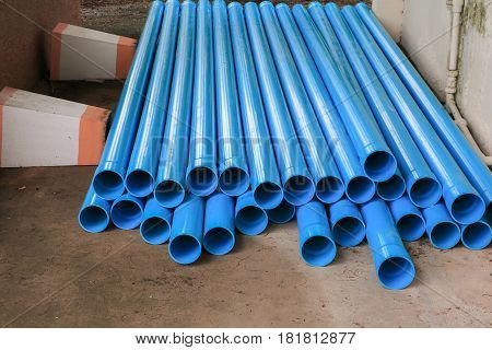 PVC plastic pipe stacked in a building site.