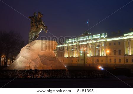 Monument to Peter the Great (Bronze Horseman, 1782) and the building of the Constitutional Court of Russia on a foggy March night, Saint-Petersburg