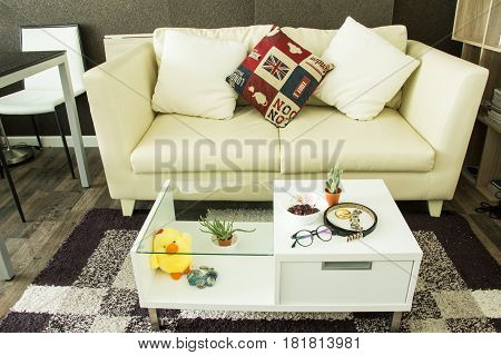 Modern interior decorated with fashionable female accessories on table