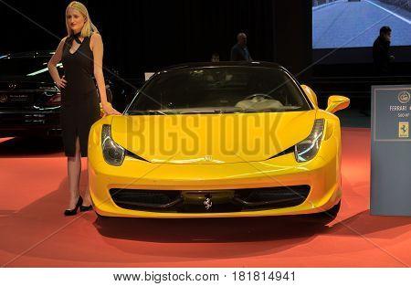 Undefined Beautiful Girl Represents Yellow Ferrari 458 Italia Car At Tel-aviv Motor Show. Israel