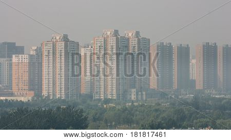 Wide Angle Horizontal  Shot Of  Buildings In Beijing On A Foggy Day