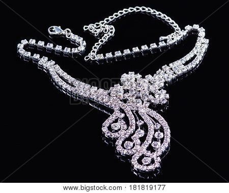 diamonds necklace shot against a black background.