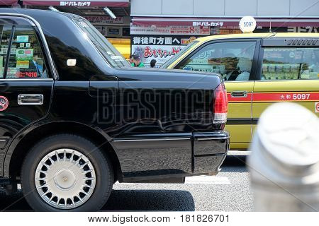 TOKYO, JAPAN - APRIL5, 2017 :Taxi cars on the street near the ueno station in Tokyo on APRIL5, 2017 in Tokyo, Several taxi cabs are waiting in line along the sidewalk.