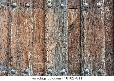 close up to old door wood with rivets