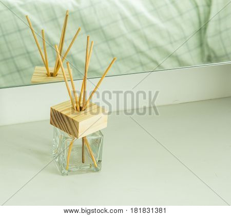 Close up handmade reed freshener on commode