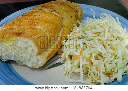 Bread and cabbage salad on the dish for dinner - French style