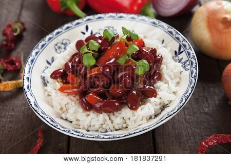 Red kidney beans served over cooked rice