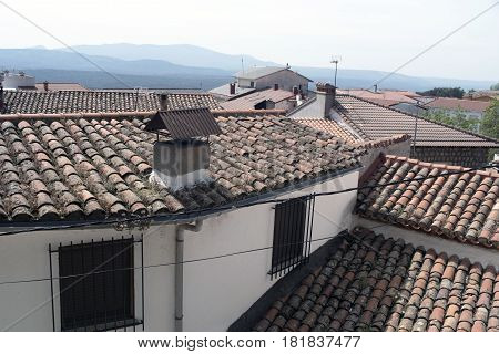 Red tile roofs in Piedralaves, Avila, Spain