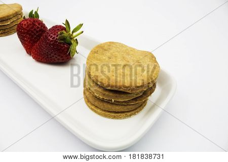 Fresh picked vibrant strawberries with fresh baked shortbread shortcake biscuits