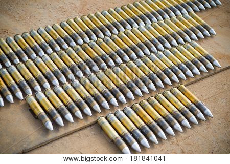 30mm cannon shells used in an onboard cannon of an AH-64 apache helicopter poster