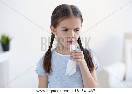 Cute little girl with allergy at home